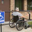 Electronic handicapped entrance - Stock Photo