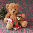 Teddy bear with Christmas presents — Stock Photo