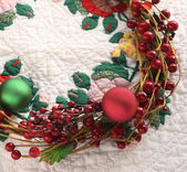 Christmas wreath on quilt — Stock Photo