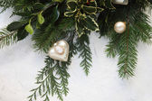 Christmas greenery with cameo ornament — Stock Photo