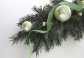 Christmas tree branch with ornaments — Stock Photo