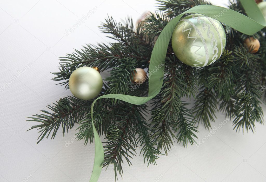 Green and gold ornaments on a branch with a green ribbon — Stock Photo #6518030