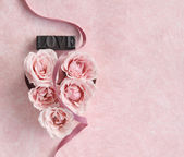 Rose heart with ribbon — Stock Photo
