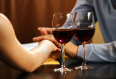 Two hands of love and red wine — Stock Photo