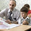 Stock Photo: Teacher and pupil