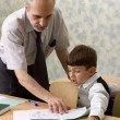 Teacher and schoolboy — Stock Photo