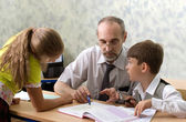 Teacher and schoolboys — Stockfoto
