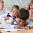 Pupils at classroom — Stock Photo