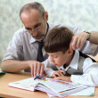 Stock Photo: Primary school. Teacher and careless pupil
