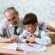 Stock Photo: Teacher and schooboy