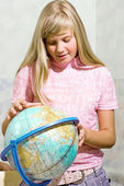 Schoolgirl & globe — Stock Photo