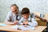 Teacher and schooboy — Stock Photo