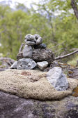 Stacked rocks on moss — Stock Photo