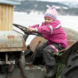 Young kid, old tractor — Stock Photo
