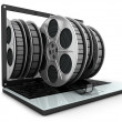Royalty-Free Stock Photo: Laptop and films