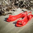 Red rubber sandals — Stok fotoğraf