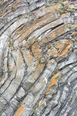 Close up of the rock consisting of stones, located layers — Stock Photo