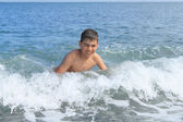 Boy in the sea — Stock Photo