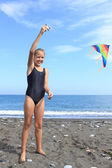 Girl flies kite — Stock Photo