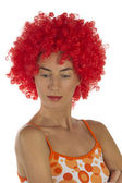 Beautiful woman in an orange wig — 图库照片