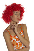 Beautiful woman in an orange wig — Stock Photo