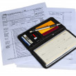 Checkbook ready to pay income tax - Stock Photo