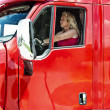 Pretty blonde woman driving a big truck - Stock Photo