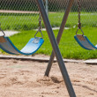 Stock Photo: Park Swings sitting idle