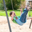Adventure on the park swing - Stock Photo
