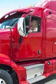 Pretty blonde woman driving a big truck — Stock Photo