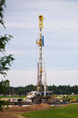 Oil rig in a cornfield — Stock Photo