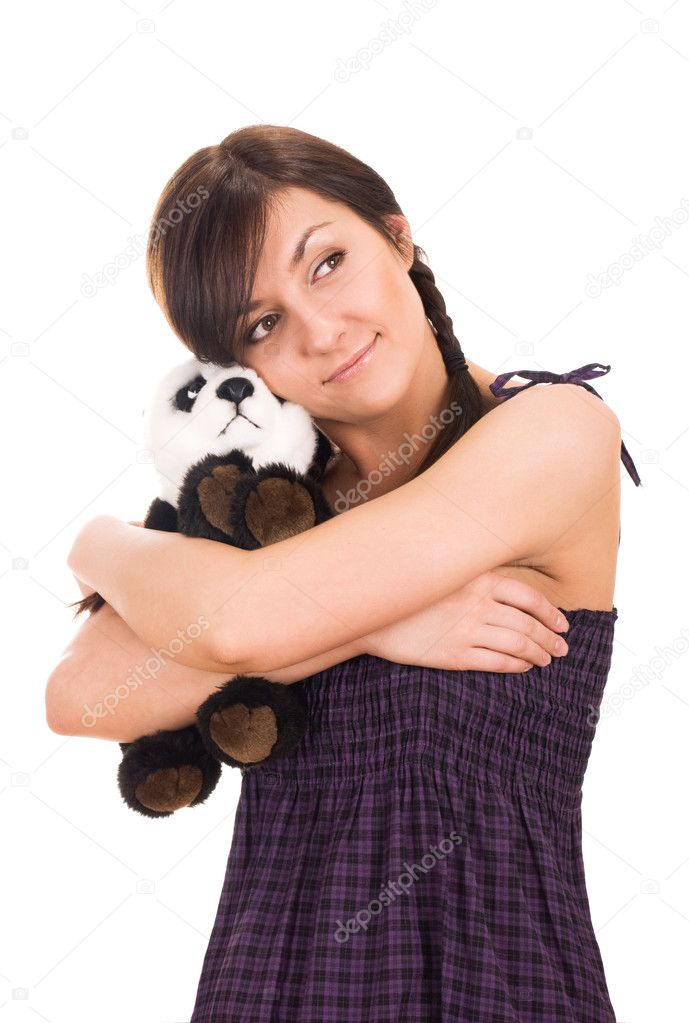 Portrait of a beautiful young woman hugging toy bear  Stock Photo #5703330