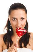 Portret kobiety ssanie jej cukierki — Zdjęcie stockowe