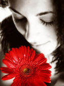 Girl with a red flower — Stock Photo