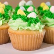 Many Easter Cupcakes with Candy Eggs — Stock Photo #5856953