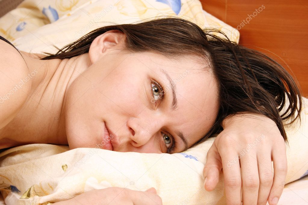 Worried woman in the bed — Stock Photo #5585704