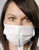 Nurse in mask with syringe — Foto Stock