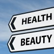 Health and beauty sign post — Stock Photo