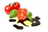 Fresh tomato with balsamic vinegar — Stock Photo