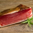 Piece of Speck - Stock Photo