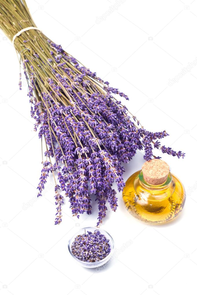 Lavender flowers with oil  isolated on white background — Stock Photo #5899805