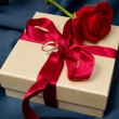 Present box and red rose — Stock Photo #6045340