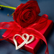 Present box and red rose — Stock Photo #6045447