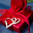 Present box and red rose — Stock Photo