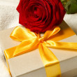 Present box and red rose — Stock Photo #6045579
