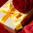 Present box and red rose — Stock Photo #6045606