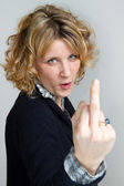 Girl who makes rude gestures — Stock Photo