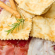 Platter of cured meats, cheeses and fried dumpling — Stock Photo #6124887