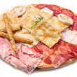 Platter of cured meats, cheeses and fried dumpling — Stock Photo #6124936