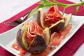 Ham with fresh fig — Stock Photo